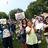 HADLEY GREEN/Staff photo<br /> People cheer at the Rally for Love organized by Beverly High School student Eliza Michaels on Beverly Common. 8/18/17