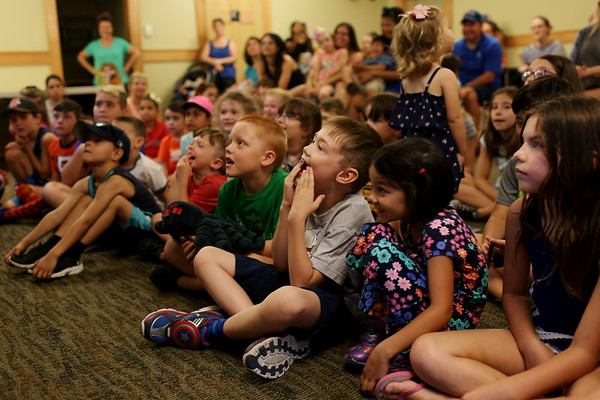 HADLEY GREEN/Staff photo<br /> Children gasp while looking at a savannah monitor lizard at the Rainforest Reptiles show at the Flint Library in Middleton. 8/15/17