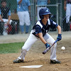 HADLEY GREEN/Staff photo<br /> Peabody's Thomas Fabbo (11) bunts while up to bat at the Peabody v. Lynn Gallant baseball championship game at the Harry Ball Field in Beverly. 8/15/17