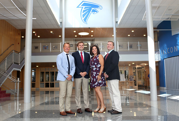 HADLEY GREEN/Staff photo<br /> From left, Todd Maguire, director of curriculum, Jason Colombino, principal, Katrina Esparza, assistant principal for grades nine and 10, and Sean Emberley, assistant principal for grades 11 and 12, stand in the atrium of Danvers High School. 8/28/17