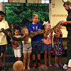HADLEY GREEN/Staff photo<br /> Children hold a boa constrictor at the Rainforest Reptiles show at the Flint Library in Middleton. 8/15/17