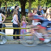 RYAN HUTTON/ Staff photo<br /> Spectators watch as the races turn on to Washington Square West during the men's professional race of the 10th Annual Witches Cup bicycle race around Salem Common on Wednesday night.