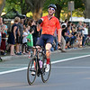 RYAN HUTTON/ Staff photo<br /> Connonr Jennings, of Portsmouth, NH, crosses himself after taking second place in the men's professional race of the 10th Annual Witches Cup bicycle race around Salem Common on Wednesday night.