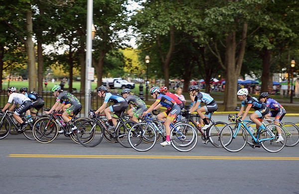 RYAN HUTTON/ Staff photo<br /> Riders in the women's professional race dash down Washington Square West during the 10th Annual Witches Cup bicycle race around Salem Common on Wednesday night.
