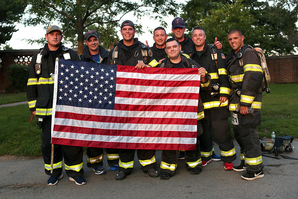HADLEY GREEN/Staff photo<br /> Despite the August heat, Beverly firefighters ran the Beverly Homecoming Road Race with their gear and oxygen tanks. 8/03/17