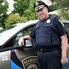 HADLEY GREEN/Staff photo<br /> Peabody Police Chief Thomas Griffin stands next to one of the two new electric patrol cars from BMW. <br /> <br /> 08/29/17