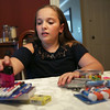 HADLEY GREEN/Staff photo<br /> Rising fourth grader Elise Moore goes through school supplies she bought for the new school year. 08/29/17