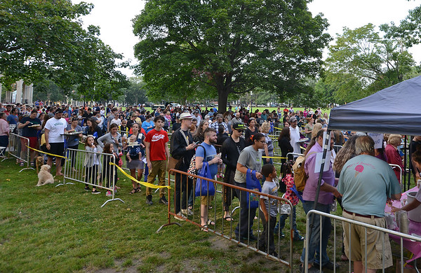 RYAN HUTTON/ Staff photo<br /> Hundreds of people wait in line to sample the many types of ice cream available at the Salem Heritage Days Ice Scream Bowl at the Salem Common on Tuesday.