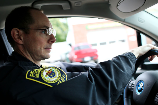 HADLEY GREEN/Staff photo<br /> Peabody patrol officer Rick Cameron drives in one of the new electric patrol cars from BMW. <br /> <br /> 08/29/17