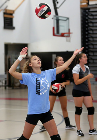 HADLEY GREEN/Staff photo<br /> Sophomore Brigitte Andrews practices serving during a Salem High girls varsity volleyball practice. 8/25/17