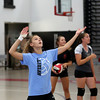 HADLEY GREEN/Staff photo<br /> Sophomore Brigitte Andrews practices serving during a Salem High girls varsity volleyball practice. 8/25/17