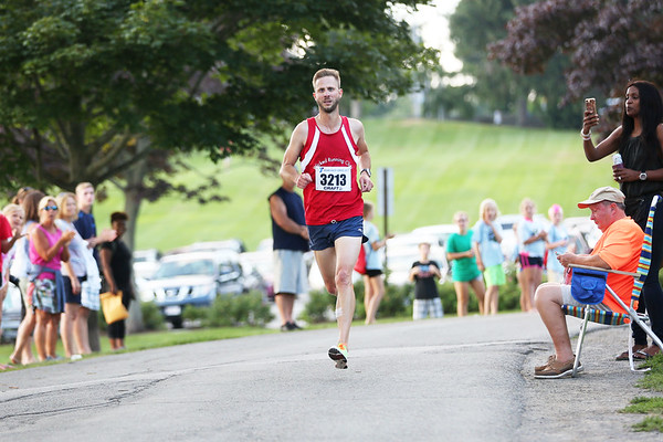 HADLEY GREEN/Staff photo<br /> Jonah Hulbert comes in first at the Beverly Homecoming Road Race at Lynch Park. 8/03/17