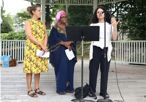 HADLEY GREEN/Staff photo<br /> From left, Reverend Julie Flowers of First Baptist Church, Esther Ngotho of Gateway Presbyterian Church of Boston, and Rabbi Alison Adler of Temple B'nai Abraham led an interfaith prayer at the Rally for Love on Beverly Common. 8/18/17