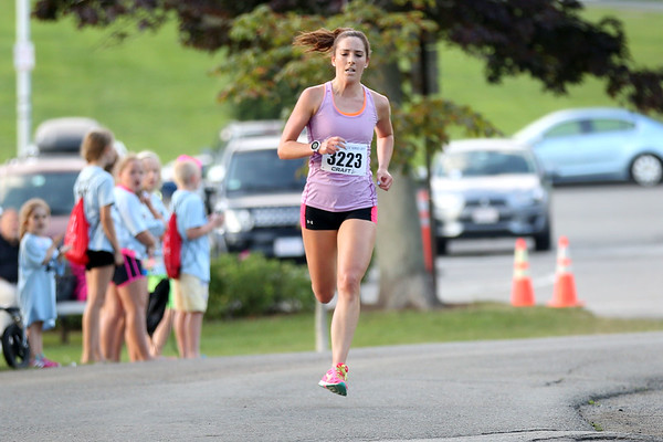 HADLEY GREEN/Staff photo<br /> Katelyn Kiel comes in first for women at the Beverly Homecoming Road Race at Lynch Park. 8/03/17