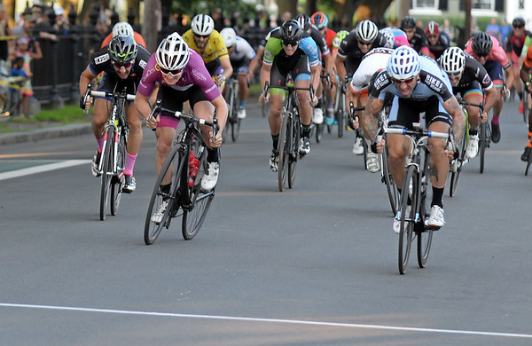 RYAN HUTTON/ Staff photo<br /> Lucas Fortini, of Fairfield, CT, left, and Adam Myerson, of Boston, right, battle for third place in the final feet of the men's professional race of the 10th Annual Witches Cup bicycle race around Salem Common on Wednesday night.