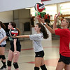 HADLEY GREEN/Staff photo<br /> Players and coaches practice serving during Salem High's girls varsity volleyball team practice. 8/25/17