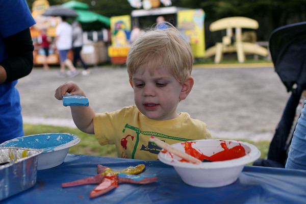 HADLEY GREEN/Staff photo<br /> Callum Moloy, 3, of Salem, paints a starfish at the 29th Salem Maritime Festival. 8/05/17