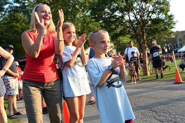 HADLEY GREEN/Staff photo<br /> People cheer for runners nearing the finish line at the Beverly Homecoming Road Race at Lynch Park. 8/03/17