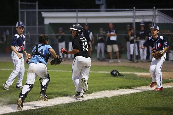 HADLEY GREEN/Staff photo<br /> Peabody's Daniel Zizza (44) tags Lynn's Elorian Bonilla (13) out at the Peabody v. Lynn Gallant baseball championship game at the Harry Ball Field in Beverly. 8/15/17