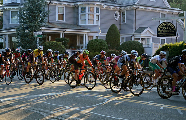 RYAN HUTTON/ Staff photo<br /> Racers in the the men's professional race speed down North Washington Square during the 10th Annual Witches Cup bicycle race around Salem Common on Wednesday night.