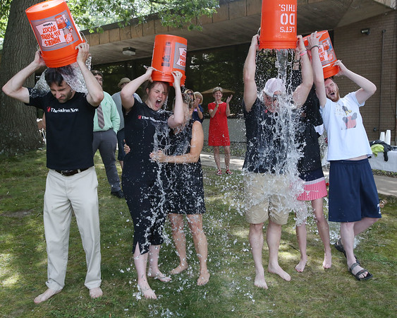 Ken Yuszkus/Staff photo      The Salem News employees from left, reporter/editor John Castelluccio, editor Muriel Hoffacker Wixson, regional publisher Karen Andreas, reporter Ethan Forman, reporter Arianna MacNeil, and editorial assistant Michael Cronin take the ice bucket challenge.     8/14/17