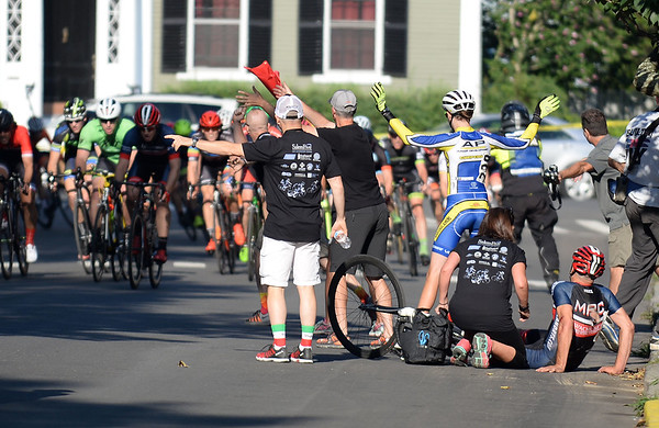 RYAN HUTTON/ Staff photo<br />  Race officials and riders wave the peloton around a crash on South Washington Square that injured at least two riders during the final legs of the men's amateur race of the 10th Annual Witches Cup bicycle race around Salem Common on Wednesday night.