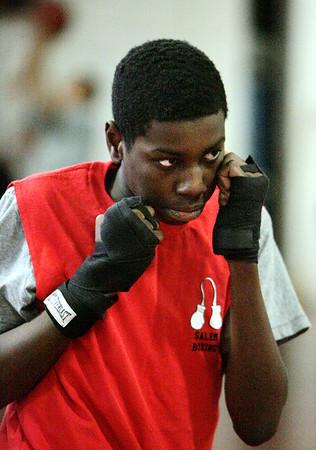 KEN YUSZKUS/Staff photo. Salem High boxer Matt Ogbebor practices in the school gym.  12/17/14
