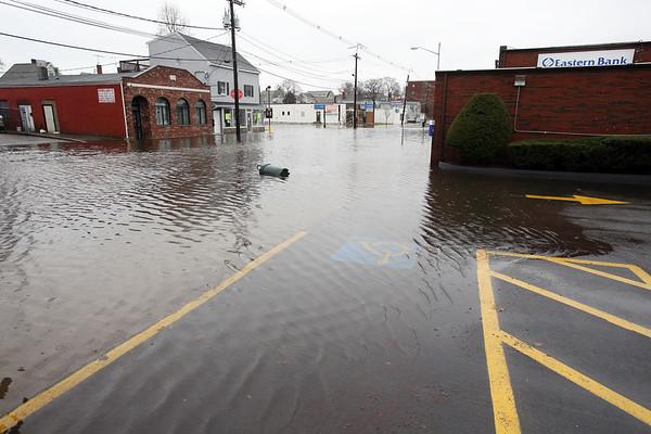 KEN YUSZKUS/Staff photo.  Flooded Foster Street in Peabody.   12/10/14