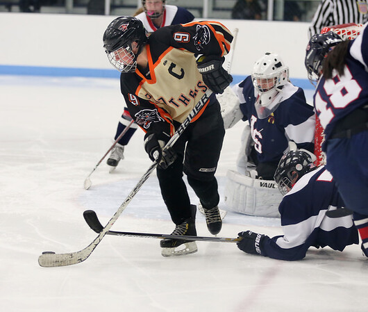 KEN YUSZKUS/Staff photo.   Beverly's Anna O'Neill has the puck in front of the goal during the Beverly vs. Lincoln-Sudbury girls hockey in the North Shore Girls Ice Hockey Classic at Endicott College  12/31/15.