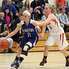 DAVID LE/Staff photo. Danvers senior captain Hannah Llewellyn (11) drives past Ipswich freshman Katherine Noftall (13). 12/11/15.