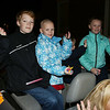 KEN YUSZKUS/Staff photo.  Grand Marshal Riley Fessenden, center, waves along with two of her siblings at the start of The Grand Procession Parade from the open convertible leading the parade at Beverly's New Year celebration.    12/31/15.