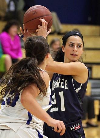 DAVID LE/Staff photo. Pingree junior Gabrielle Assad (21) looks to pass against Dana Hall. 12/9/15.