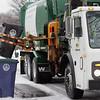 KEN YUSZKUS/Staff photo.   Trash pickup along Maple Street in Salem.   12/29/15.