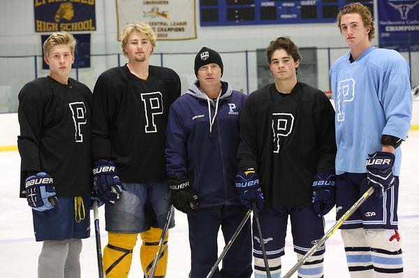KEN YUSZKUS/Staff photo.   Peabody High School's Head coach Mark Leonard, center, with captains from left, Pat McCarthy, Donny Shaw, Aron Dollin, Owen Brewster at practice.   12/14/15.