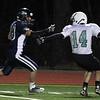 DAVID LE/Staff photo. Essex Tech junior Jackson Leete (18) cuts back and blows past McCann Tech senior Keigan Case (14) to the end zone for a long touchdown. 12/3/15.