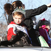 Austin Krafton of Andover, the 2015 Topsfield Fair's Junior King, waves to onlookers during Beverly's 68th annual Holiday Parade Sunday, Nov. 29, as they march down Elliot Street.