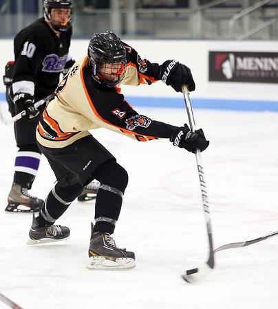 KEN YUSZKUS/Staff photo.   Beverly's Ryan Munzing let's one fly toward the the goal during the Beverly vs. Shawsheen boys hockey. 12/30/15.