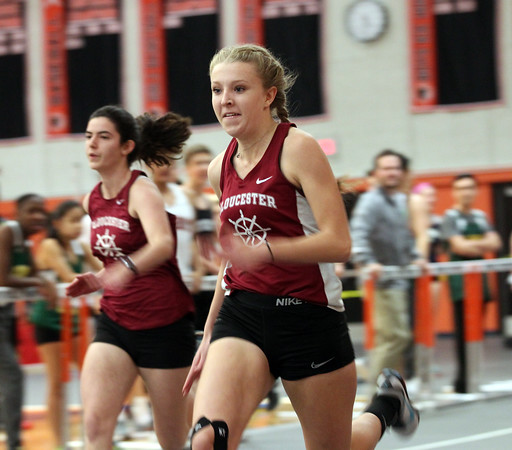 DAVID LE/Staff photo. Gloucester senior Sierra Rudolph sprints towards the finish line in a blur as she wins the 55m dash in a meet against Lynn Classical on Tuesday afternoon at Beverly High School. 12/20/16