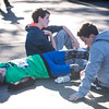 SAM GORESH/Staff photo. From left: Ryan Monahan, 13, Collin Tiberii, 14, and Marty Cooke, 13, rest after finishing the Law Enforcement Torch Run at Analogic benefitting the Special Olympics. 12/4/16