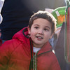 SAM GORESH/Staff photo. Dillon Lang, 5, watches Santa Claus before the start of the Law Enforcement Torch Run at Analogic benefitting the Special Olympics. 12/4/16
