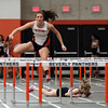 DAVID LE/Staff photo. Beverly senior Natalie Coughlin leaps over a hurdle well ahead of the field as she wins the 55m hurdles against Winthrop on Tuesday afternoon. 12/20/16