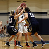 DAVID LE/Staff photo. Gordon freshman guard Meghan Foley (4) gets trapped by two Brandeis defenders on Saturday afternoon. 12/10/16.