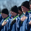 SAM GORESH/Staff photo. Recruits from the Essex County Sheriffs Department Academy stand during the national anthem at the start of the Law Enforcement Torch Run at Analogic benefitting the Special Olympics. 12/4/16