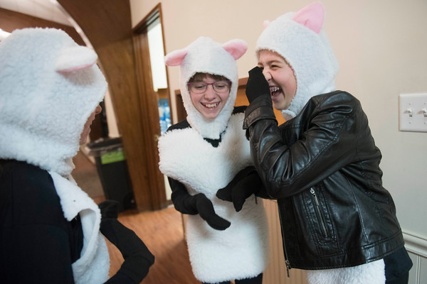 """SAM GORESH/Staff photo. From left: Emma Hatch, Marissa Bell and Ivee Dunbar laugh as they play a games while waiting to perform in """"All About that Baby,"""" at Holy Trinity United Methodist Church in Danvers. """"All About that Baby,"""" tells the story of the Nativity through the perspective of a Shepherd named Nathaniel and his taking sheep. 12/24/16"""