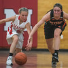 SAM GORESH/Staff photo. Masconomet freshman Mak Graves and Beverly senior Natalie Mellinger chase a loose ball in the Masconomet Girls Basketball Holiday Invitational. 12/27/16