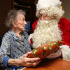 Santa delivering gifts to residents at Hunt Nursing Home
