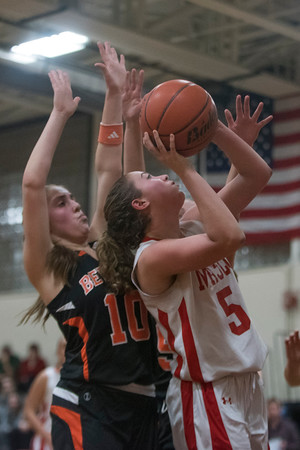SAM GORESH/Staff photo. Masconomet junior Paige Amyouny goes up for a basket as Beverly senior Natalie Mellinger attempts to stop her on defense in the Masconomet Girls Basketball Holiday Invitational. 12/27/16