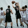 SAM GORESH/Staff photo. Marblehead senior Mack Fisher goes up for a basket as Gloucester senior Nate Young and junior Brandon Rivera attempt to stop him in their game at at Gloucester High School. 12/16/16