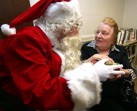 Santa delivering gifts to residents at Hunt Nursing Home