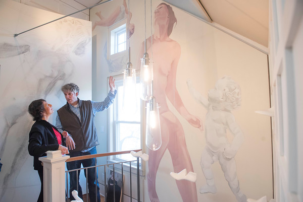 SAM GORESH/Staff photo. Artist Thomas Darsney (right) talks to house captain Kathleen Keefe Ternes (left) in the museum room of him home the Edwin H. Dodge House during the Christmas in Salem House Tour. 12/4/16